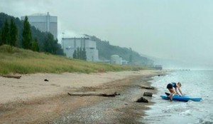 A kayaker shoves off onto Lake Michigan from the beach at Van Buren State Park near the Palisades Nuclear Powerplant.  Grand Rapids Press File Photo