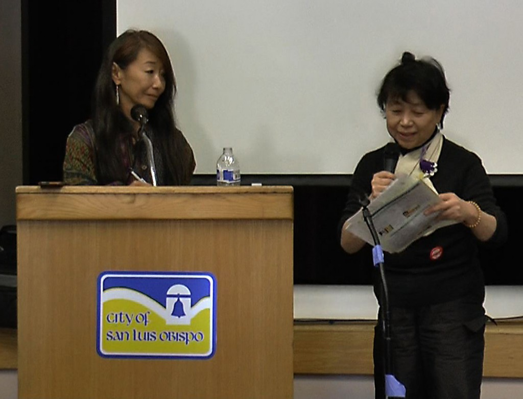 Carole Hisasue (left) from Mothers for Peace translates for Fukushima refugee Chieko Shiina at the recent national Shutdown Diablo Conference in San Luis Obispo, CA.  EON photo.