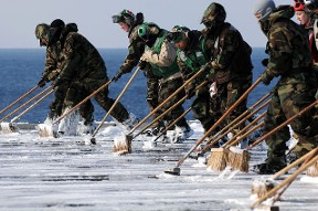 Sailors attempt to remove Fukushima radioactive fallout from the deck of aircraft carrier USS Ronald Reagan in 2011. File photo.